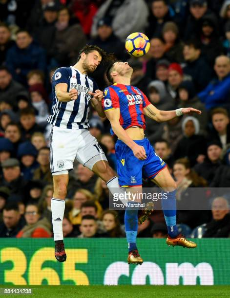 Jay Rodriguez of West Bromwich Albion and Joel Ward of Crystal Palace battle to win a header during the Premier League match between West Bromwich...