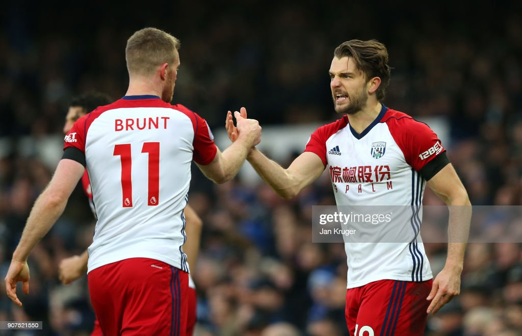 Jay Rodriguez of West Bromwich Albion celebrates after scoring his sides first goal with Chris Brunt of West Bromwich Albion during the Premier League match between Everton and West Bromwich Albion at Goodison Park on January 20, 2018 in Liverpool, England.