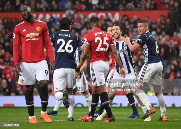 Jay Rodriguez of West Bromwich Albion celebrates after scoring his sides first goal with his team mates as Romelu Lukaku of Manchester United reacts...