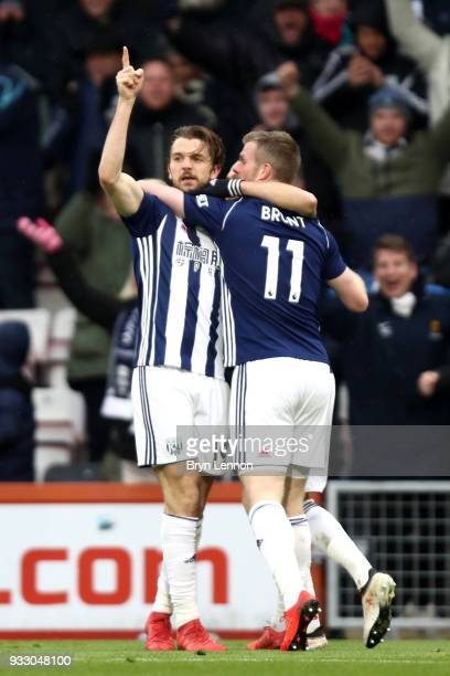 Jay Rodriguez of West Bromwich Albion celebrates scoring his side's first goal with Chris Brunt during the Premier League match between AFC...