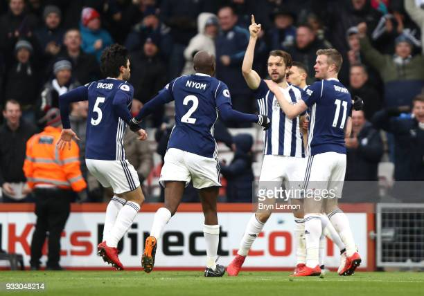 Jay Rodriguez of West Bromwich Albion celebrates scoring his side's first goal with team mates during the Premier League match between AFC...