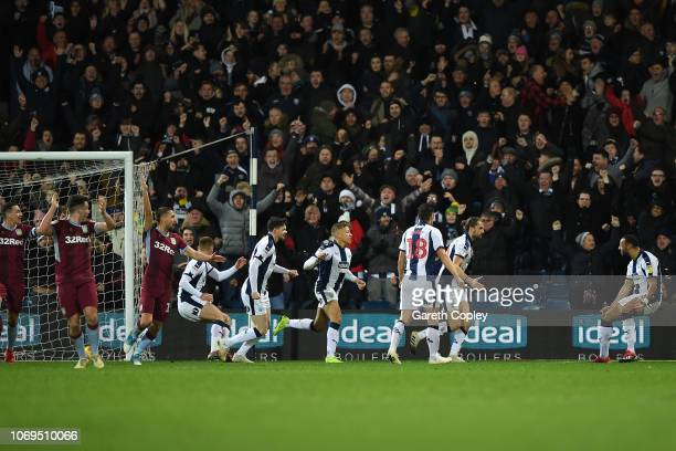 Jay Rodriguez of West Bromwich Albion celebrates with his team after scoring a last minute, equalising goal during the Sky Bet Championship match...