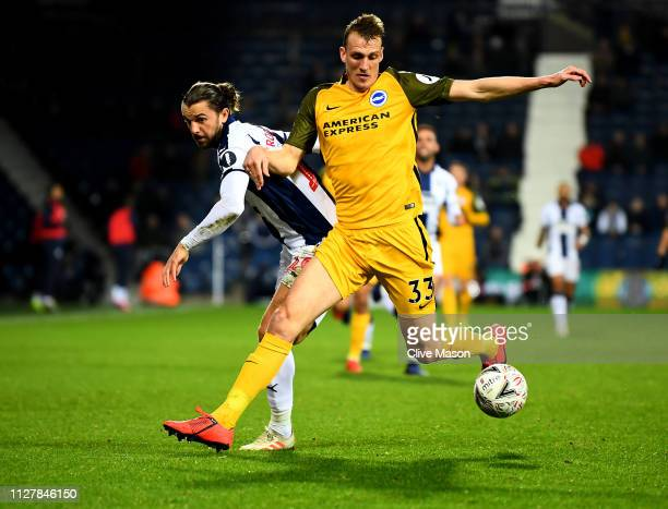 Jay Rodriguez of West Bromwich Albion is challanged by Dan Burns of Brighton Hove Albion during the FA Cup Fourth Round Replay match between West...