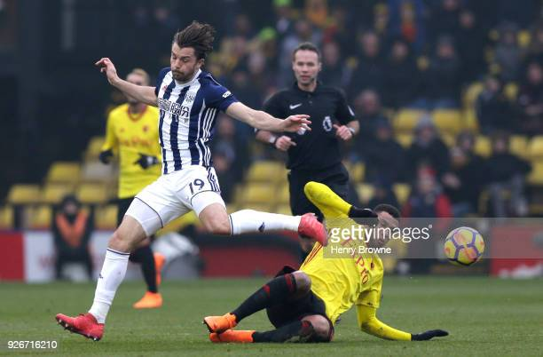 Jay Rodriguez of West Bromwich Albion jumps over Etienne Capoue of Watford during the Premier League match between Watford and West Bromwich Albion...