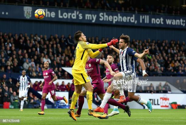 Jay Rodriguez of West Bromwich Albion scores his sides first goal past Ederson of Manchester City during the Premier League match between West...