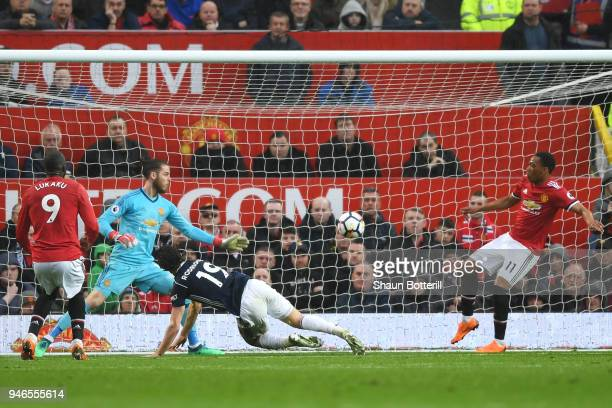 Jay Rodriguez of West Bromwich Albion scores his sides first goal past David De Gea of Manchester United as Anthony Martial of Manchester United...