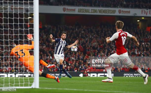 Jay Rodriguez of West Bromwich Albion shoots past Petr Cech of Arsenal but defender Nacho Monreal of Arsenal clears during the Premier League match...