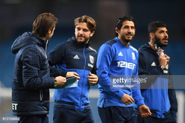 Jay Rodriguez of West Bromwich Albion speaks to Grzegorz Krychowiak of West Bromwich Albion prior to the Premier League match between Manchester City...