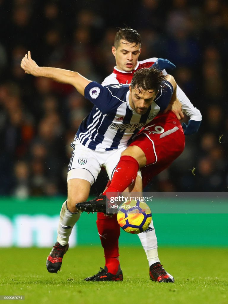Jay Rodriguez of West Bromwich Albion tangles with Granit Xhaka of Arsenal during the Premier League match between West Bromwich Albion and Arsenal at The Hawthorns on December 31, 2017 in West Bromwich, England.