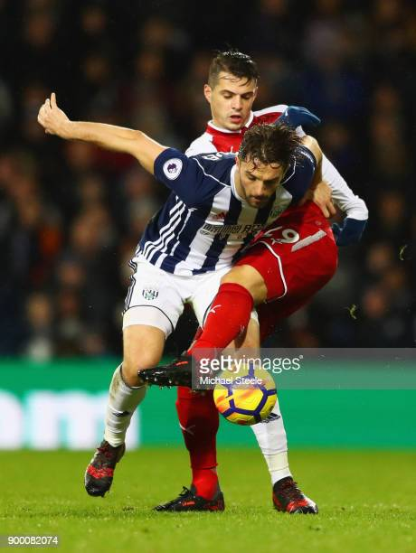 Jay Rodriguez of West Bromwich Albion tangles with Granit Xhaka of Arsenal during the Premier League match between West Bromwich Albion and Arsenal...