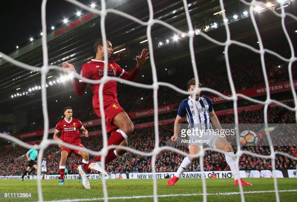 Jay Rodriguez of West Bromwich Albion watches on as Joel Matip of Liverpool scores an own goal during The Emirates FA Cup Fourth Round match between...