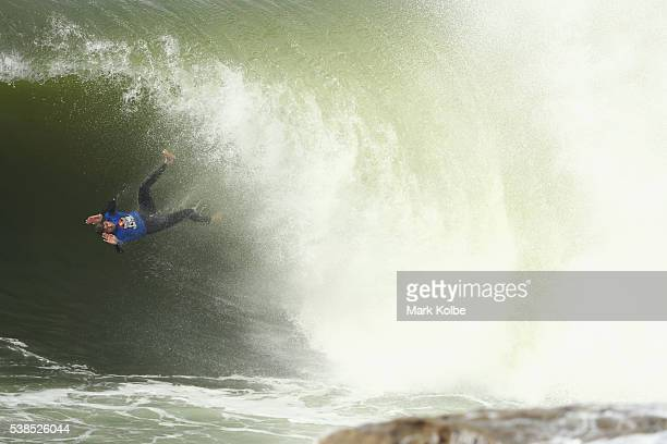 Jay 'Rooster' Adams of Australia wipes out as he competes during the Red Bull Cape Fear surfing event at Cape Solander Kamay Botany Bay National Park...