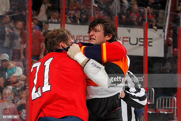 Jay Rosehill of the Philadelphia Flyers and Krys Barch of the Florida Panthers fight during first period action at the BBT Center on November 25 2013...