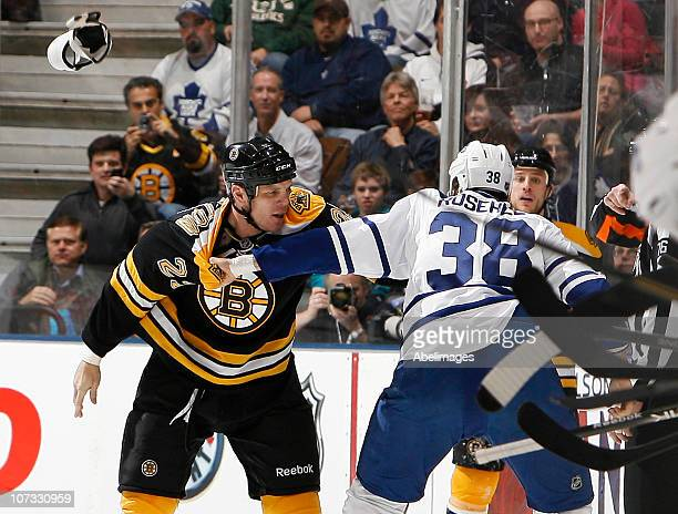 Jay Rosehill of the Toronto Maple Leafs fights Shawn Thornton of the Boston Bruins during game action at the Air Canada Centre December 4 2010 in...