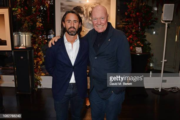 Jay Rutland and JeanClaude Biver attend the TAG Heuer auction featuring unseen art work from the Don't Crack Under Pressure Campaign in association...