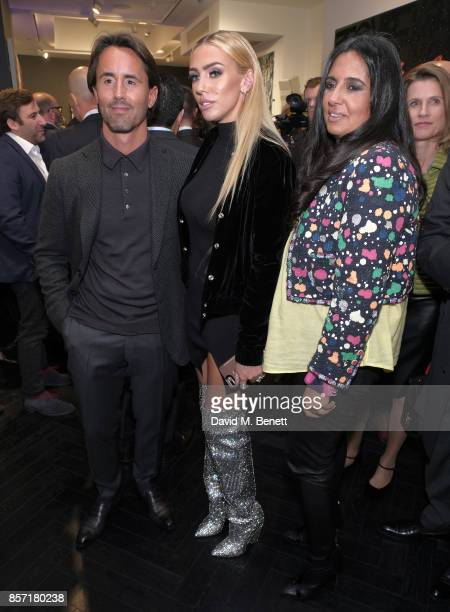 Jay Rutland and Petra Ecclestone attend RETNA's Exhibition supported by Ciroc Victor Jet Rolls Royce at the Maddox Gallery on October 3 2017 in...