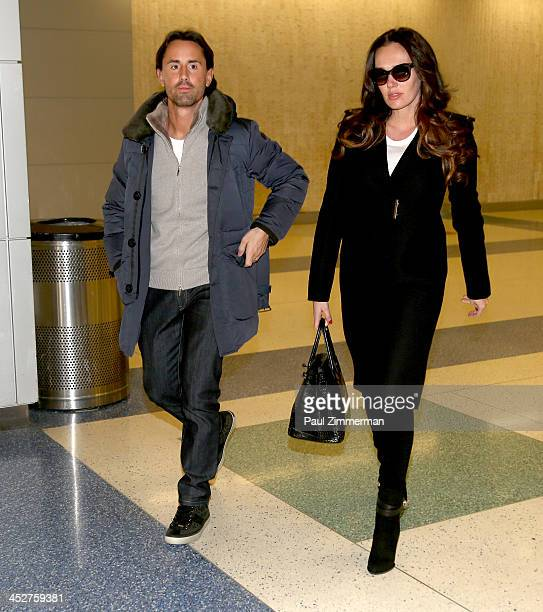 Jay Rutland and Tamara Ecclestone are pictured arriving at JFK airport from London on December 1 2013 in the Queens borough of New York City
