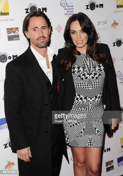 Jay Rutland and Tamara Ecclestone attend ZOOM a Formula 1 photographic charity auction in aid of Great Ormond Street at InterContinental Park Lane...