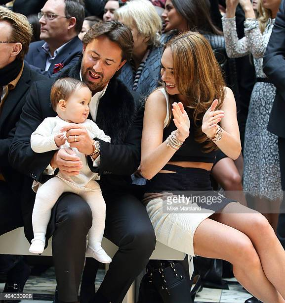 Jay Rutland and Tamara Ecclestone with baby Sophia attend the Julien Macdonald show during London Fashion Week Fall/Winter 2015/16 on February 21...