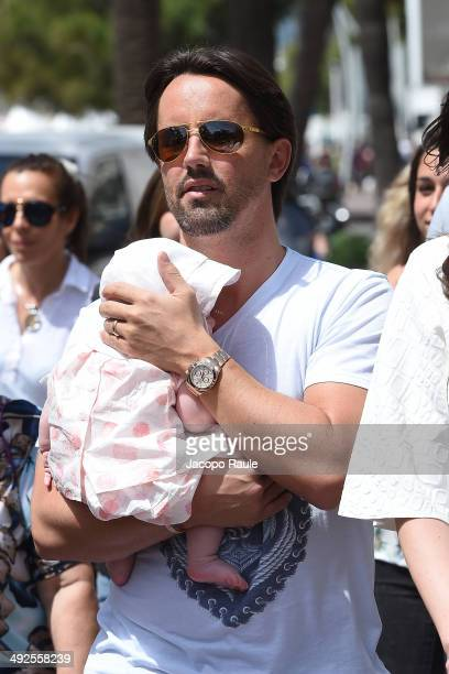 Jay Rutland is seen with his new baby Sophia on day 8 of the 67th Annual Cannes Film Festival on May 21 2014 in Cannes France