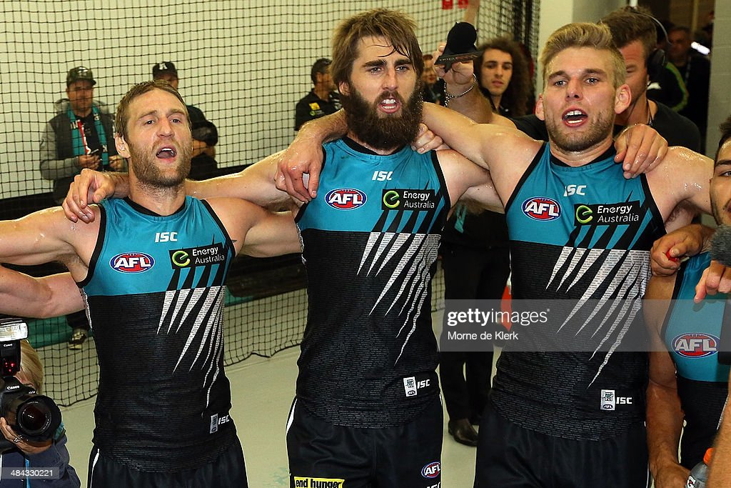 Jay Schulz, Justin Westhoff and Jackson Trengove celebrate after the round 4 AFL game between Port Adelaide and the Brisbane Lions at Adelaide Oval on April 12, 2014 in Adelaide, Australia.