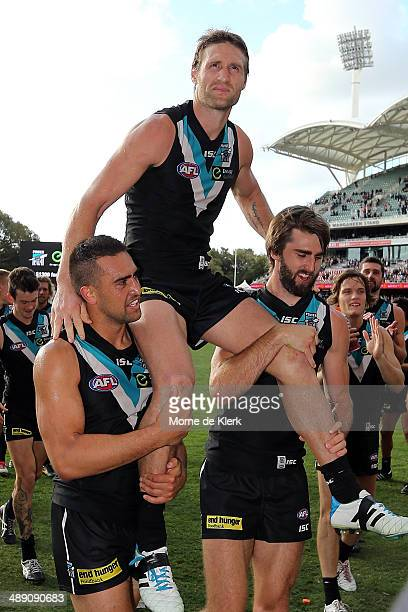 Jay Schulz of the Power is chaired off by his teammates after his 150th game during the round eight AFL match between the Port Adelaide Power and...