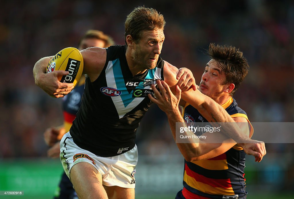 Jay Schulz of the Power is tackled by Matthew Jaensch of the Crows during the round five AFL match between the Adelaide Crows and the Port Adelaide Power at Adelaide Oval on May 3, 2015 in Adelaide, Australia.