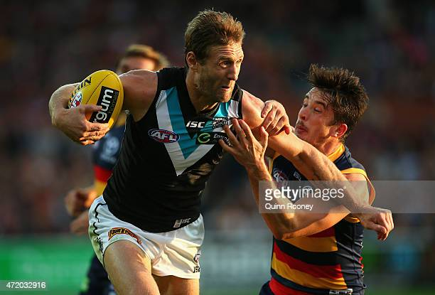 Jay Schulz of the Power is tackled by Matthew Jaensch of the Crows during the round five AFL match between the Adelaide Crows and the Port Adelaide...