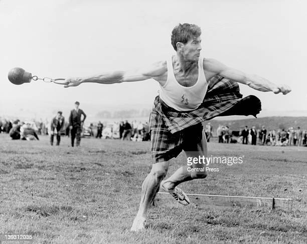 Jay Scott of Loch Lomond competing in the weight throw event at the Blackford Highland Games Blackford Perthshire Scotland 1st June 1959