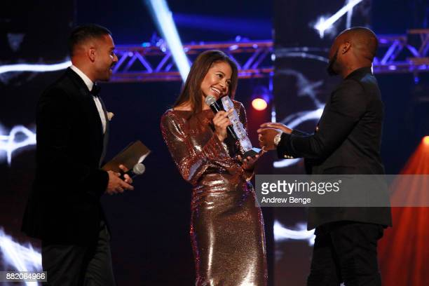 Jay Sean and viscountess Emma Weymouth present the Best African award to Davido on stage at the MOBO Awards at First Direct Arena Leeds on November...