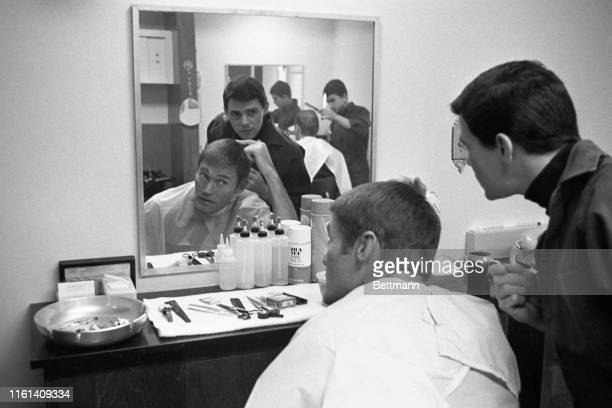 """Jay Sebring, who might well be called Hollywood's """"head man,"""" styles the hair of movie star Chuck Connors. Sebring has built a fortune in only six..."""