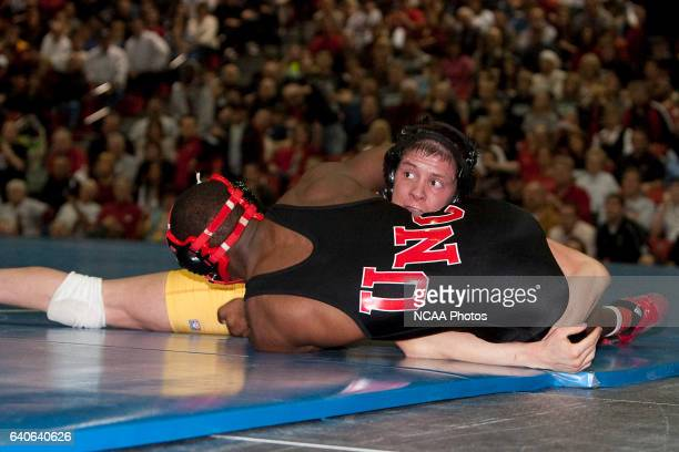 Jay Sherer of Augustana eyes the referee during the Division II Men's Wrestling Championship held at the Sapp Fieldhouse on the University of...