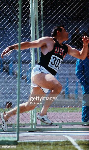 Jay Silvester of Smithfield Utah throws the discus 10/14 for a new Olympic record 207 feet 91/2 inches His toss bettered the old mark of 200 feet...