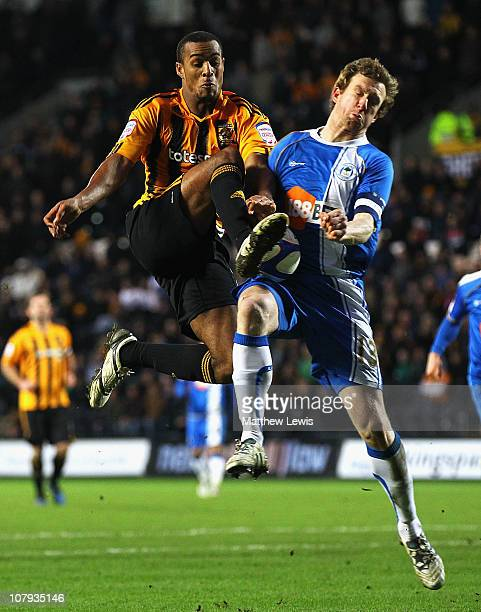 Jay Simpson of Hull and Steven Caldwell of Wigan challenge for the ball during the FA Cup sponsored by Eon 3rd Round match between Hull City and...