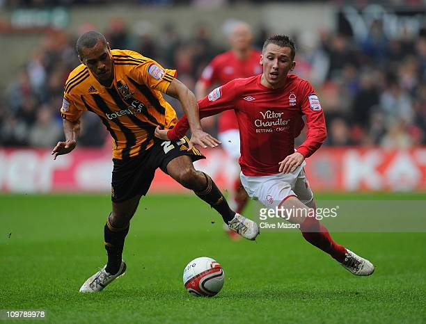 Jay Simpson of Hull City is challenged by Radoslaw Majewski of Nottingham Forest during the npower Championship match between Nottingham Forest and...