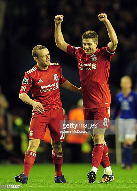 Jay Spearing and Steven Gerrard of Liverpool celebrate victory in the Barclays Premier League match between Liverpool and Everton at Anfield on March...