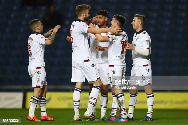 Jay Spearing Mark Beevers Gary Madine Chris Long and Josh Vela of Bolton celebrate the third goal an own goal scored by Chey Dunkley of Oxford during...