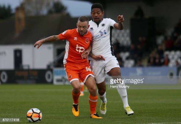 Jay Spearing of Blackpool and Angelo Balanta of Boreham Wood battle for possession during the Emirates FA Cup First Round match between Boreham Wood...