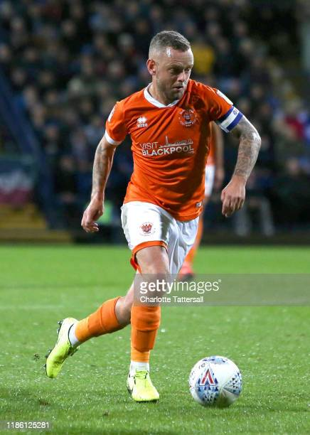 Jay Spearing of Blackpool FC runs with the ball during the Sky Bet Leauge One match between Bolton Wanderers and Blackpool at University of Bolton...