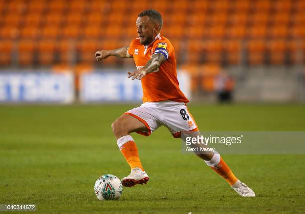Jay Spearing of Blackpool runs with the ball during the Carabao Cup Third Round match between Blackpool and Queens Park Rangers at Bloomfield Road on...