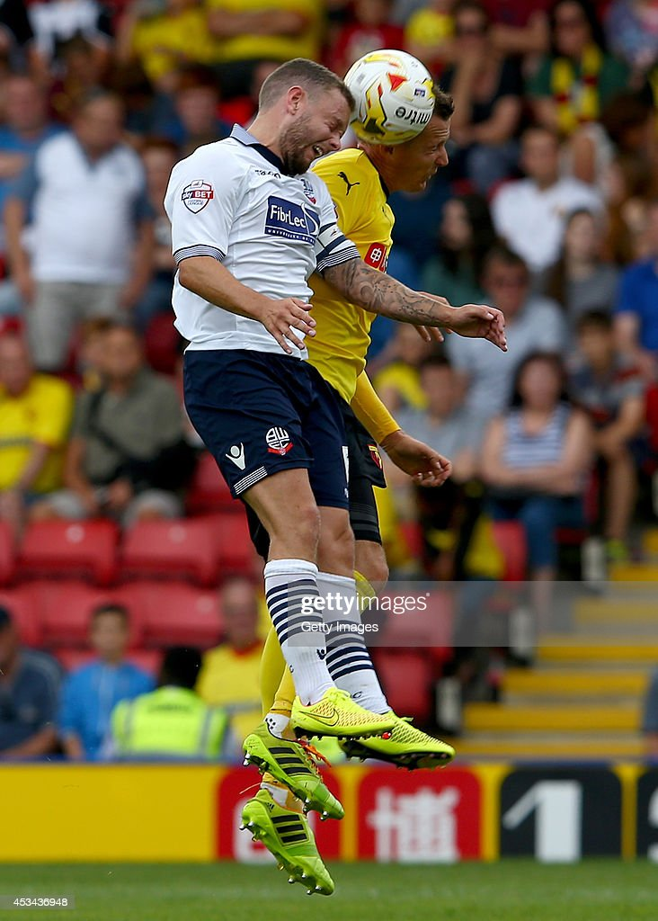 Jay Spearing of Bolton Wanderers and Daniel Tozser of Watford battle for the ball during the Sky Bet Championship match between Watford and Bolton Wanderers at Vicarage Road on August 9, 2014 in Watford, England.