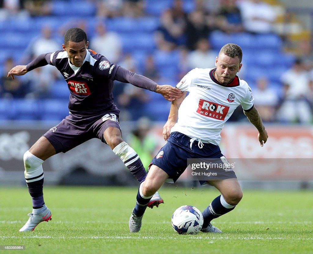 Jay Spearing (R) of Bolton Wanderers and Tom Ince of Derby County battle for the ball during the Sky Bet Championship match between Bolton Wanderers and Derby County at the Macron Stadium on August 8, 2015 in Bolton, England.