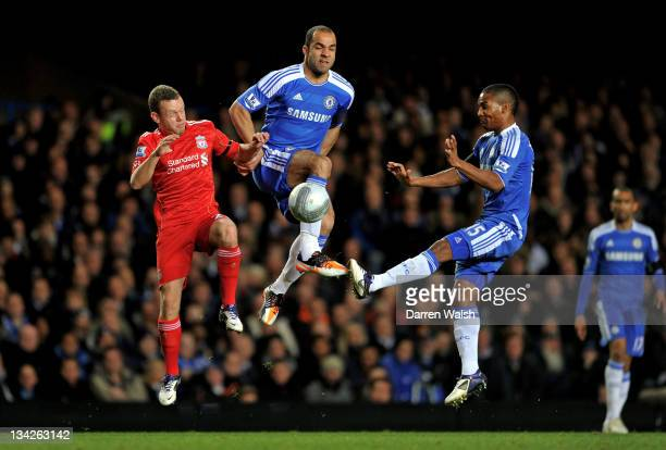 Jay Spearing of Liverpool Alex and Florent Malouda of Chelsea compete for the ball during the Carling Cup quarter final match between Chelsea and...