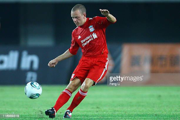 Jay Spearing of Liverpool challenges controls the ball during the preseason friendly match between Guangdong Sunray Cave and Liverpool at Guangdong...