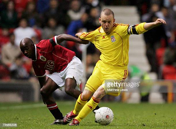 Jay Spearing of Liverpool holds off Febian Brandy of Manchester United during the FA Youth Cup second Leg match between Manchester United and...
