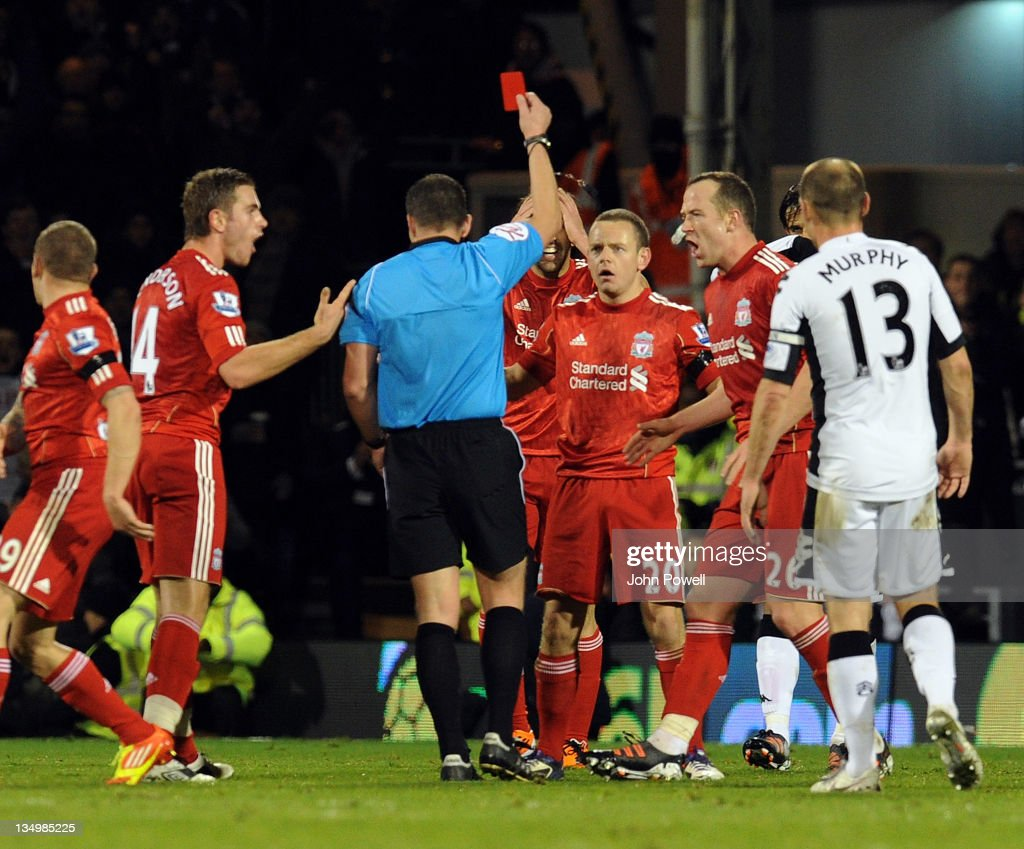 Jay Spearing of Liverpool is shown a red card during the Barclays Premier League match between Fulham and Liverpool at Craven Cottage on December 5, 2011 in London, England.