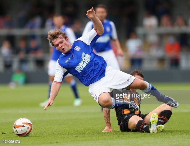 Jay Tabb of Ipswich is tackled during the pre season friendly match between Barnet and Ipswich Town at The Hive on July 20, 2013 in Barnet, England.