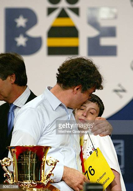 Jay Tidmarsh of South Bend Indiana congratulates his son David after he won the National Spelling Bee June 3 2004 in Washington DC Tidmarsh spelled...