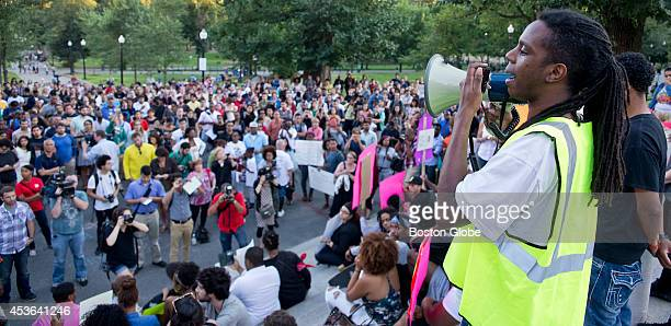 Jay Todd, pictured with a bull horn, speaks to more than 600 people during a rally on August 14, 2014 protesting the death of Michael Brown, who was...