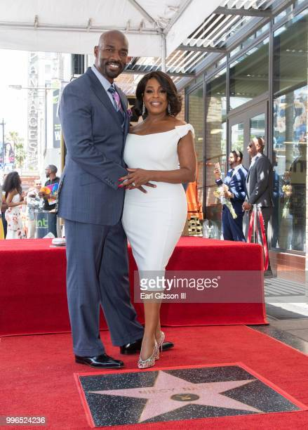 Jay Tucker and Niecy Nash pose for a photo as Niecy Nash is honored with a star on the Hollywood Walk Of Fame on July 11 2018 in Hollywood California